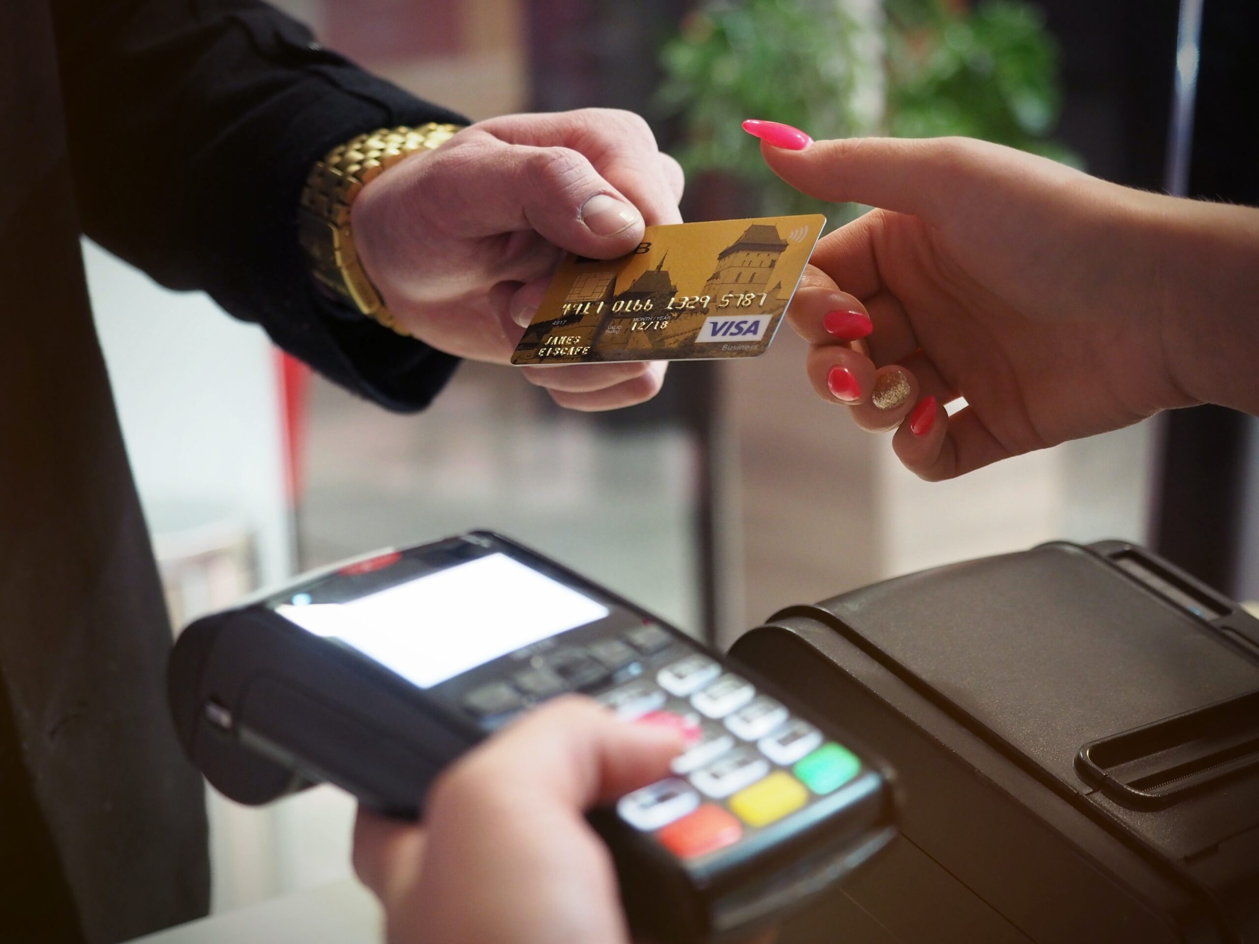 Debit card being used in India for financial or payment purposes, an essential part of the banking system.